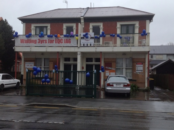 4.9.2013 CCC issued Building consent issued in May 2012 for EQ repairs. Still no action. Street party cancelled due to rain. 20m of streamers have blown away.